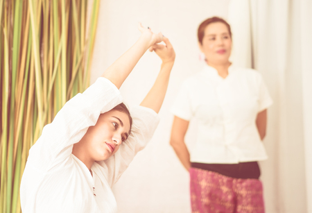 Women is stretching before Thai Massage course Stock Photo
