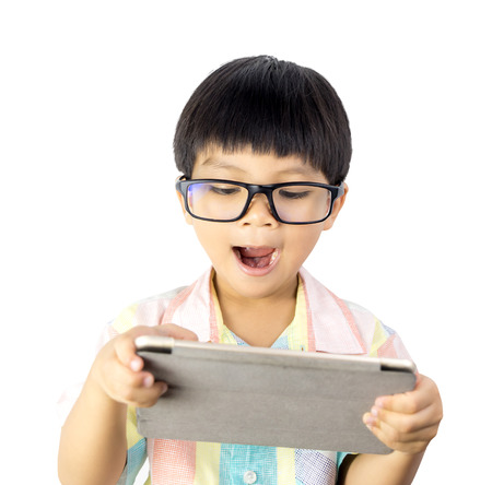 Nerdy Asian boy is surprising on the tablet isolated on white Stock fotó