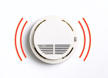 Round Fire Smoke Alarm ringing isolated on white