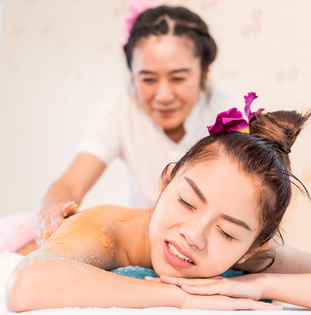 fibromyalgia: Asian women is getting hurt while recieving Spa massage Stock Photo