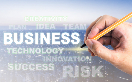 Hand writting on business modern city light  Business text