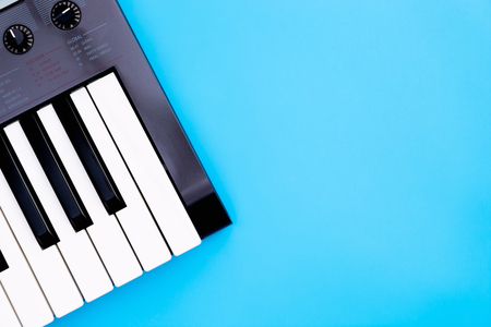 Music keyboard synthesizer instrument on blue copy space for Music poster concept Stock Photo