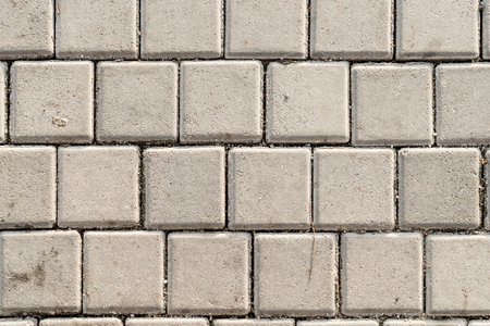 Dirty concrete footpath block floor texture background