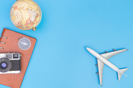 Plane toy and travel objects on blue background for travel concept