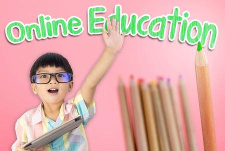 Kid raised hand for online education concept