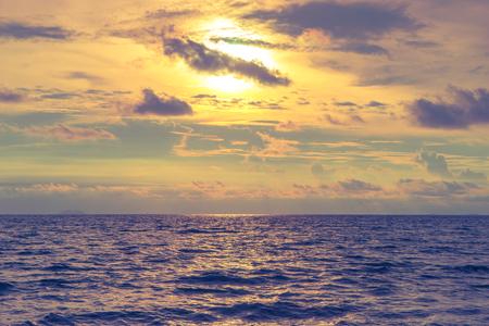 Beautiful dramatic golden sky with purple shade of ocean Фото со стока - 88763133