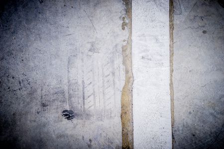 Cement concrete floor with tire track and white traffic line 版權商用圖片
