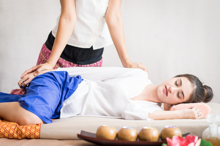 Happy Lady is relaxing getting Thai massaging side view Stock Photo
