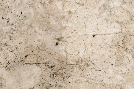 Cracked dirty grungy cement floor for texture background