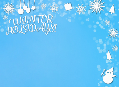 Winter Holidays paper cut backdrop on blue and white Stock Photo