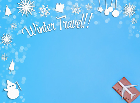 Airplane on blue background for winter travel concept Stock Photo