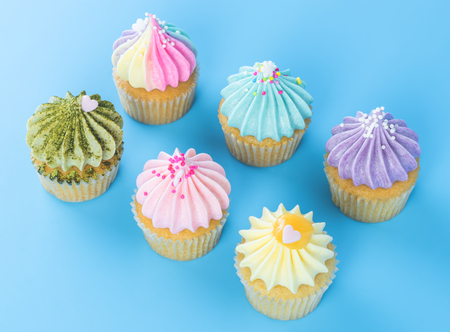 Colorful Cupcake for festival celebrate tion top view on blue background