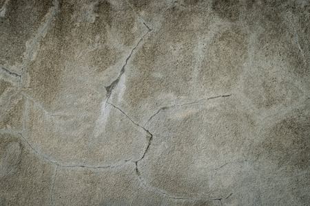 Street cement floor with cracks all through the surface Stock Photo