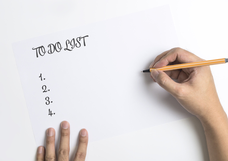 Hand writing down  To do List on white paper Stock Photo