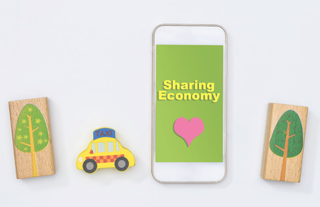 Using Sharing Economy Taxi help save the world Stock Photo