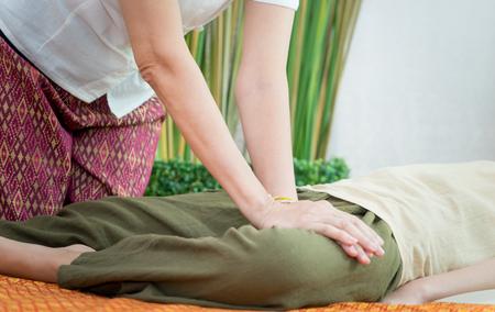 Thai Spa Therapist is massaging a woman leg Stock Photo