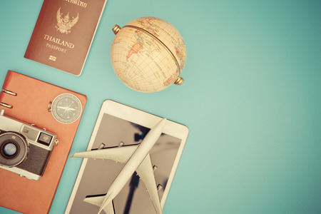 Vintage travel object on blue copy space for travel concept