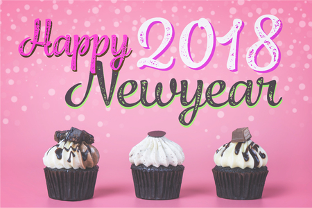 Happy 2018 newyear with cupcake for party celebration concept