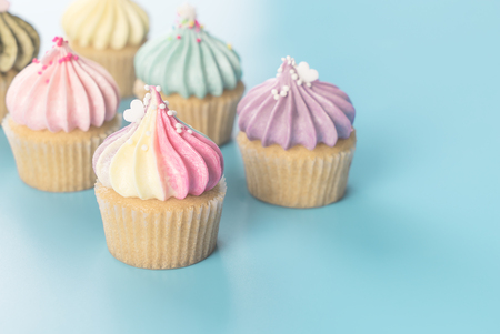 Colorful rainbow cupcake set on blue pastel color toning