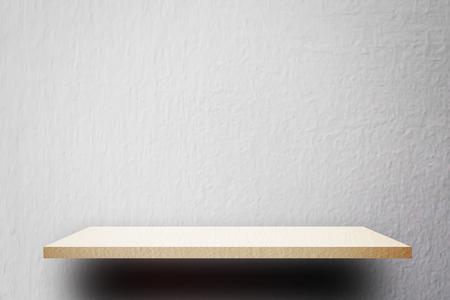 Cream empty shelf on white cement wall Stock Photo