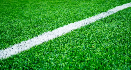 White line on artifact grass sport field for texture background 版權商用圖片