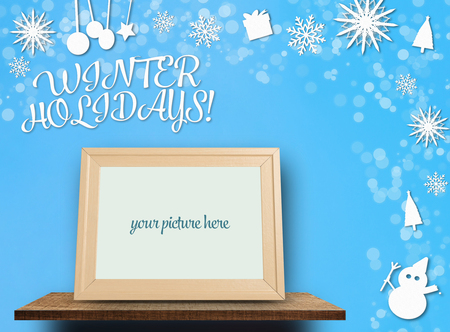 Winter Holidays paper cut backdrop with blank photoframe Stock Photo