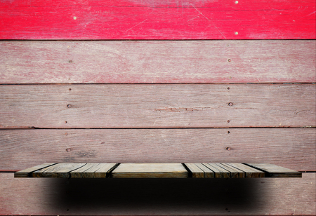 Empty wooden shlef with wooden wall and red stripe