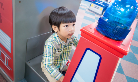 Boy is riding on a fire truck toy playground