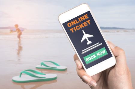 Online Travel ticket on mobile phone with Family beach concept
