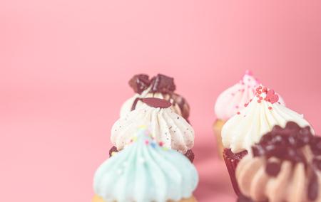 six mini cupcake on pink pastel background