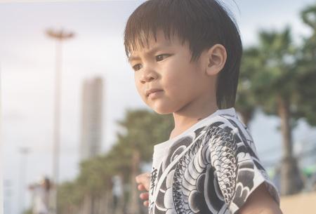 Little boy on the Beach of Pattaya Thailand Фото со стока - 92125069