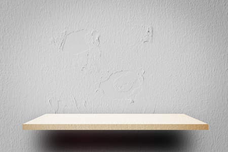 Empty white shelf on crack concrete wall for product display Stock fotó