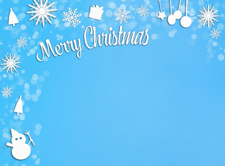 Blue and white christmas decoration paper cut out frame on blue copy space