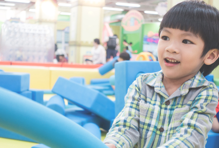 Boy is playing with Foam toy in playground