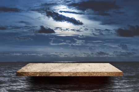 Empty rock shelf on Dark sea sky for product display Stock Photo