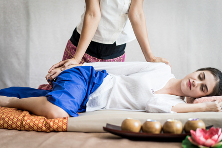 Woman is receiving arm massage in Thai Massage spa Stock Photo - 92116117