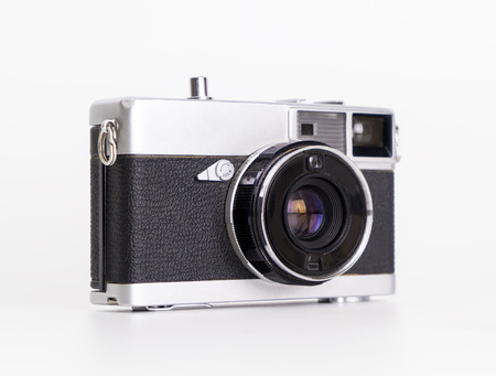 Portable vintage film camera isolated on white