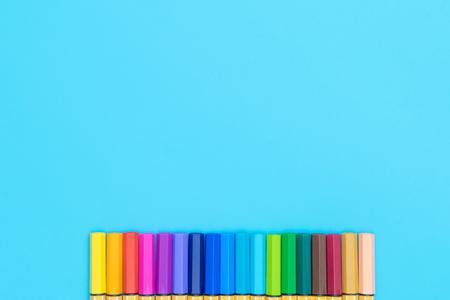 Colorful marker pen on blue copy space background Foto de archivo
