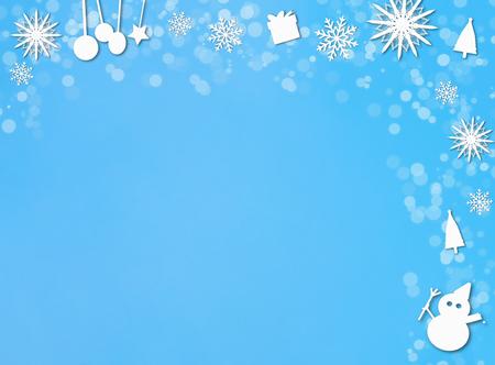 White christmas ornaments border on blue snow background