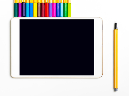Empty tablet screen with color pen markers for Art and writing concept mock up