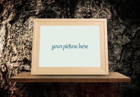 Empty Brown Wooden Photo frame with tree bark background Zdjęcie Seryjne