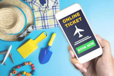 Online ticket on Mobile with Summer travel fashion and toy Zdjęcie Seryjne