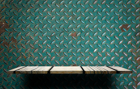 Gray wooden display shelf on green rustic metal background