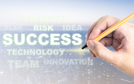 Hand writting success on business modern city light  copy space for text Stock Photo