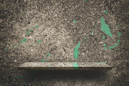Dirty Cement counter display with green paint splashed Banco de Imagens