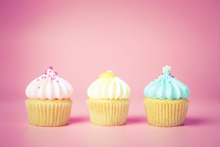 Three Mini Fancy cupcake on pink background, pastel tone Banco de Imagens