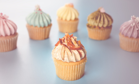Mini Cupcake with almond surrounded by fancy cupcake