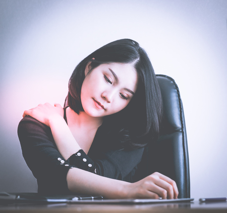 Office worker having injury on her shoulder from office work health problem