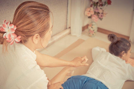 Woman is getting her leg massage by Thai Spa Therapist Stock Photo