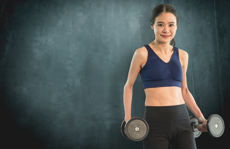 Slim workout woman with dumbbell for sport concept